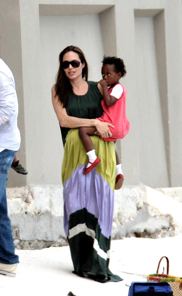"A pregnant Angelina Jolie gives daughter Zahara a lift. Zahara was adopted from Ethiopia in 2005. Leo-Lins/<a href=""http://www.x17online.com"" target=""new"">X17 Online</a> - February 7, 2008"