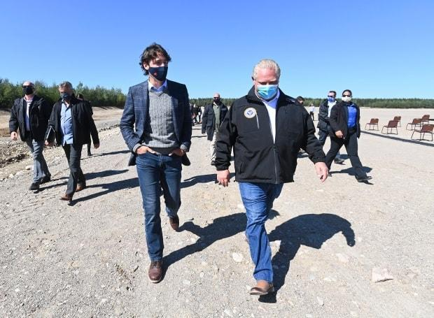 Prime Minister Justin Trudeau, left, talks with Ontario Premier Doug Ford after taking part in a groundbreaking event at the Iamgold Cote Gold mining site in Gogama, Ont., on Friday, September 11, 2020.