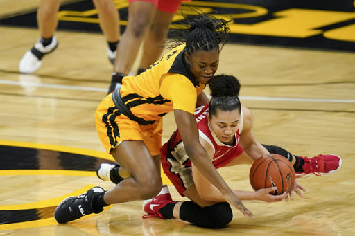 Iowa guard Tomi Taiwo, left, fights for a loose ball with Ohio State guard Madison Greene, right, during the first half of an NCAA college basketball game, Wednesday, Jan. 13, 2021, in Iowa City, Iowa. (AP Photo/Charlie Neibergall)