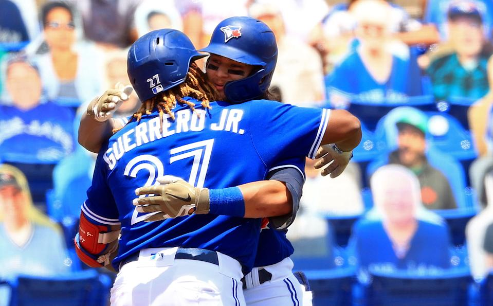 DUNEDIN, FLORIDA - MAY 16: Bo Bichette #11 of the Toronto Blue Jays is congratulated by Vladimir Guerrero Jr. #27 after a one run home run in the first inning during a game against the Philadelphia Phillies at TD Ballpark on May 16, 2021 in Dunedin, Florida. (Photo by Mike Ehrmann/Getty Images)