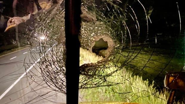 Todd Laffin was driving northbound on Highway 102 when his windshield was hit by a large rock, sending glass flying throughout his tractor-trailer. (Submitted by Todd Laffin - image credit)