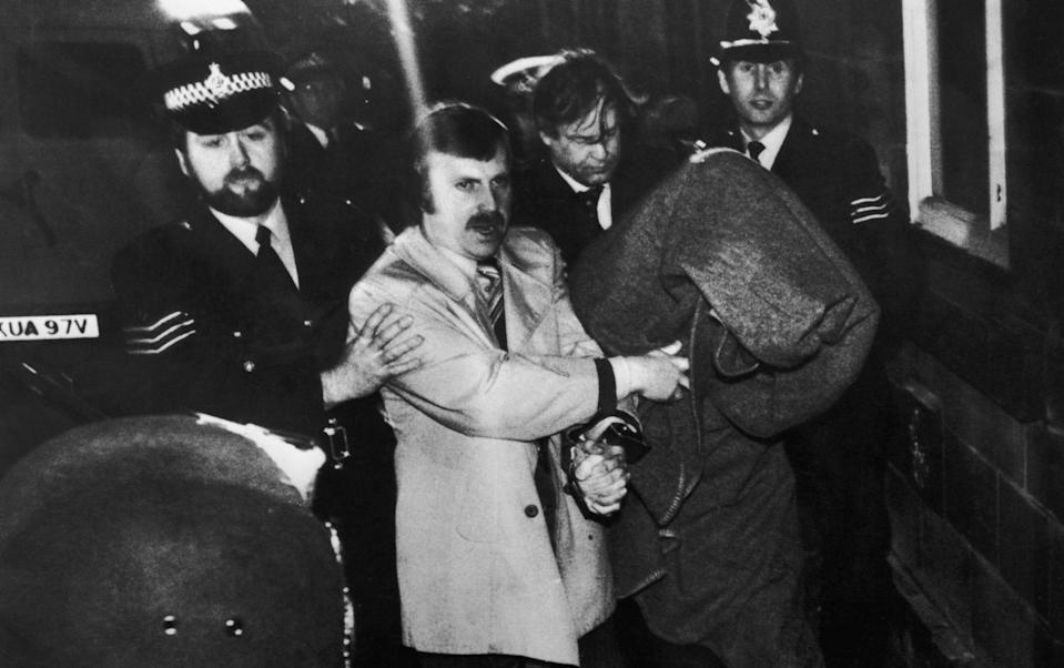 Peter Sutcliffe being escorted into Dewsbury Magistrates Court to be charged with murder on January 6 1981 - Keystone/HULTON ARCHIVE