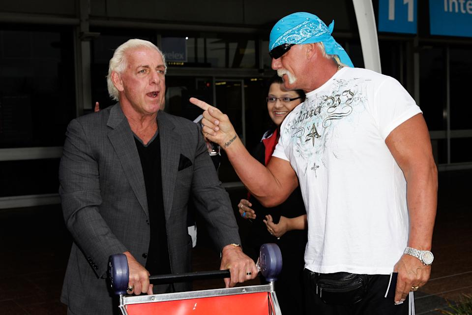 SYDNEY, AUSTRALIA - NOVEMBER 17:  Hulk Hogan (R) and Ric Flair arrive at Sydney Airport, ahead of the Australian Hulkamania tour on November 17, 2009 in Sydney, Australia.  (Photo by Brendon Thorne/Getty Images)
