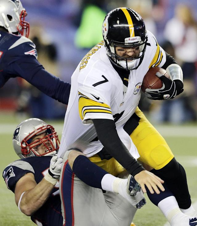 New England Patriots linebacker Dane Fletcher, bottom left, sacks Pittsburgh Steelers quarterback Ben Roethlisberger (7) in the fourth quarter of an NFL football game Sunday, Nov. 3, 2013, in Foxborough, Mass. The Patriots won 55-31. (AP Photo/Charles Krupa)