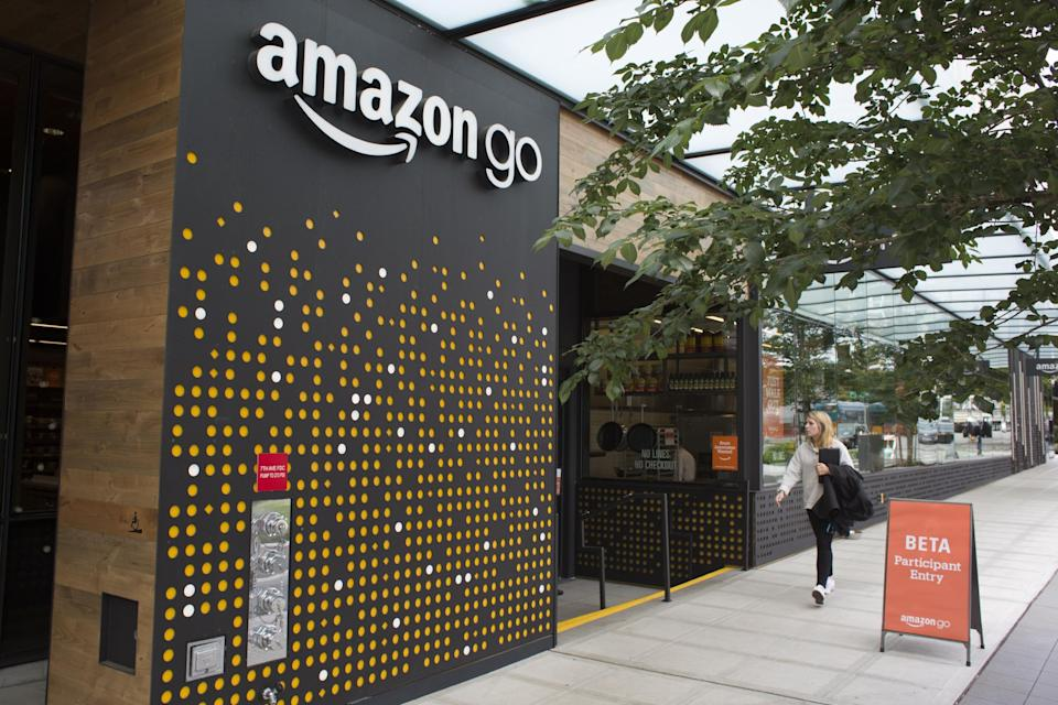 A woman walks past the Amazon Go grocery store at the Amazon corporate headquarters on June 16, 2017 in Seattle, Washington. (David Ryder/Getty Images)