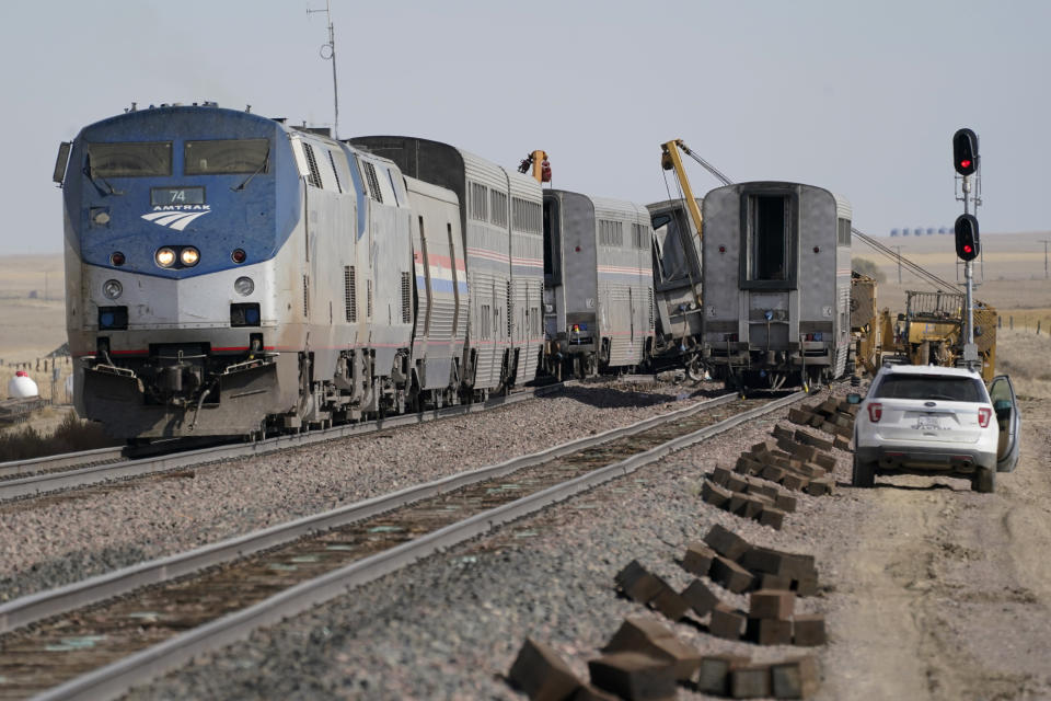 Engines and cars from an Amtrak train that derailed a day earlier are shown Sunday, Sept. 26, 2021, at the derailment site just west of Joplin, Mont. The crash killed three people and injured others. The westbound Empire Builder was en route to Seattle from Chicago, with two locomotives and 10 cars. (AP Photo/Ted S. Warren)