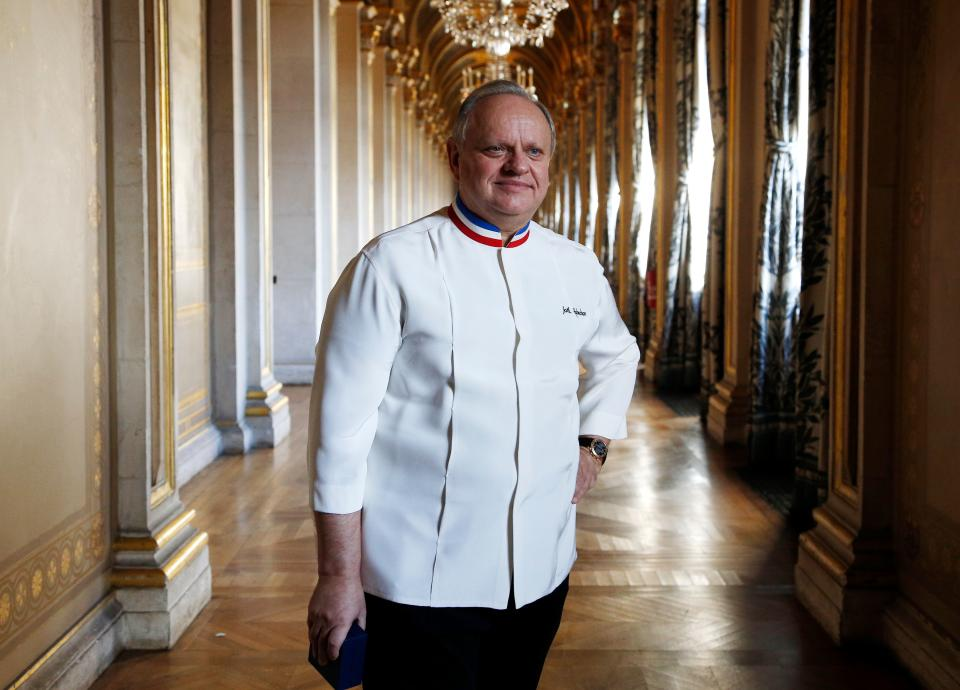 French chef Joel Robuchon posed in a corridor on January 14, 2016 in the Hotel de ville of Paris during the Grand Vermeil award ceremony, rewarding the best chefs of Paris. (Photo by FRANCOIS GUILLOT / AFP)        (Photo credit should read FRANCOIS GUILLOT/AFP via Getty Images)