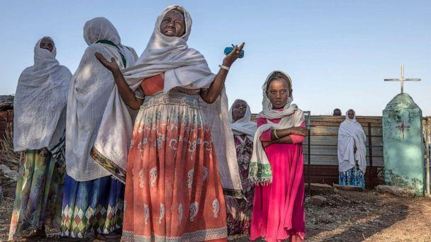 PHOTO: A Tigrayan woman who fled the conflict in Ethiopia's Tigray region prays after Sunday Mass ends at a nearby church in the Umm Rakouba refugee camp in Qadarif, eastern Sudan, Nov. 29, 2020. (Nariman El-mofty/AP)