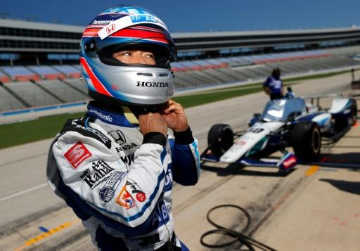 Former Indianapolis 500 winner Takuma Sato, shown preparing for practice, crashed on his warm-up lap and missed the race