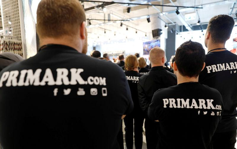 FILE PHOTO: Employees stand in the new Primark store during its opening day in Berlin, Germany October 18, 2018. REUTERS/Michele Tantussi
