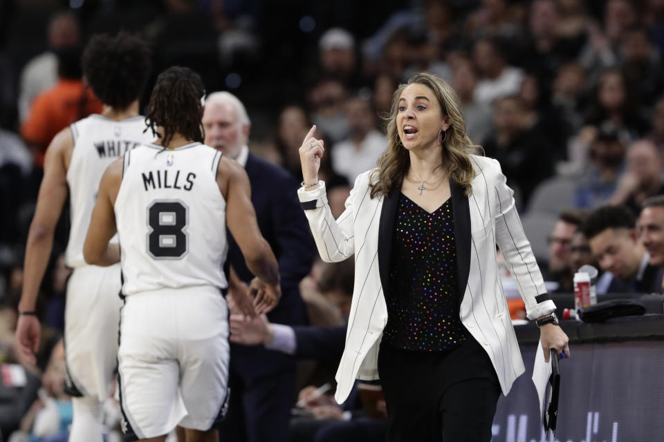 San Antonio Spurs assistant coach Becky Hammon signals to players during the first half of an NBA basketball game against the Toronto Raptors in San Antonio, Sunday, Jan. 26, 2020. (AP Photo/Eric Gay)
