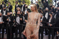 Candice Swanepoel poses for photographers upon arrival at the premiere of the film 'Annette' and the opening ceremony of the 74th international film festival, Cannes, southern France, Tuesday, July 6, 2021. (AP Photo/Brynn Anderson)