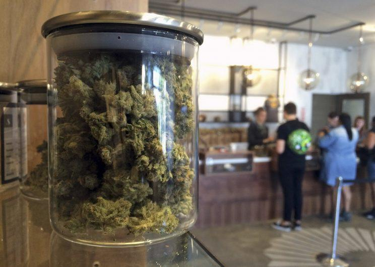 Customers purchase products at the Harvest Medical Marijuana Dispensary in San Francisco, April 2016. (Photo: Haven Daley/AP)