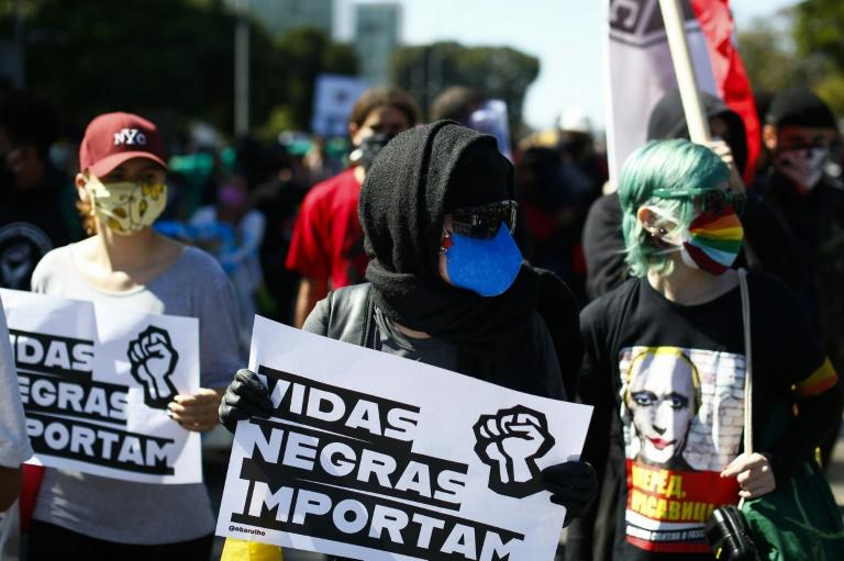 """Protesters against President Jair Bolsonaro in Brasilia held placards denouncing """"fascism"""" and supporting the Black Lives Matter movement (AFP Photo/Sergio LIMA)"""