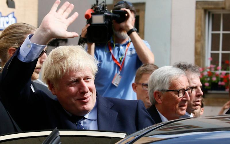 Putting a brave face on?Boris Johnson waves as he leaves a lunch meeting withEuropean Commission President Jean-Claude Juncker in Luxembourg yesterday - REX
