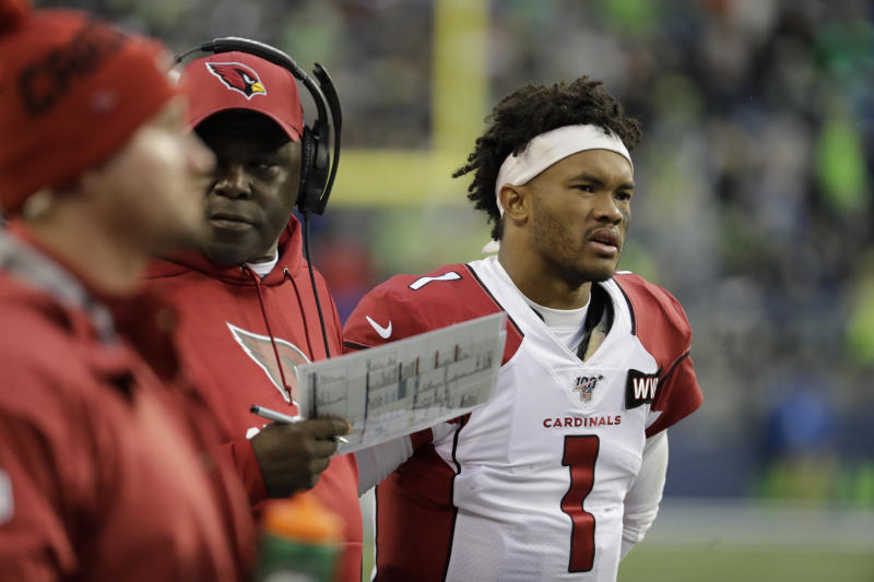 In this Dec. 22, 2019, photo, Arizona Cardinals quarterback Kyler Murray stands on the sidelines during the second half of an NFL football game against the Seattle Seahawks in Seattle. Murray's impressive first season is early proof that the Arizona Cardinals made a good decision when they selected the quarterback with the No. 1 overall pick in April. (AP Photo/Lindsey Wasson)