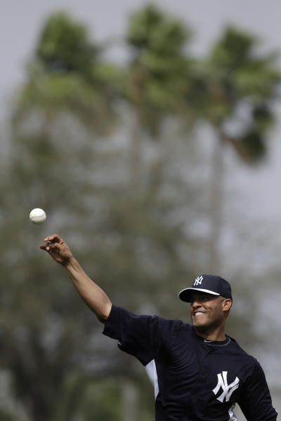 New York Yankees' Mariano Rivera throws to home during a workout at baseball spring training, Wednesday, Feb. 13, 2013, in Tampa, Fla. (AP Photo/Matt Slocum)