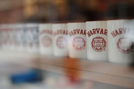 FILE PHOTO: Mugs bearing the school's logo are displayed for sale outside Harvard University in Cambridge, Massachusetts, U.S., June 18, 2018. REUTERS/Brian Snyder