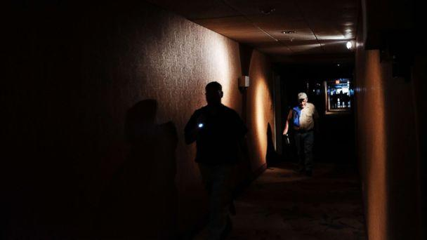 PHOTO: Hotel guests walk through dark hallways after the electricity was lost as Hurricane Irma arrives into southwest Florida, Sept. 10, 2017 in Fort Myers, Florida. (Spencer Platt/Getty Images)