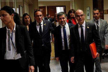 Jailed Catalan politicians Josep Rull, Jordi Sanchez and Jordi Turull leave after getting their parliamentary credentials at Spanish Parliament, in Madrid, Spain, May 20, 2019. REUTERS/Susana Vera