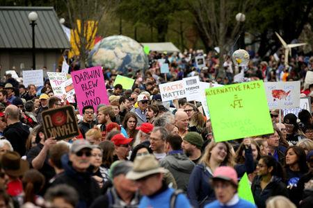 Protestors hold signs during the March For Science in Seattle, Washington, U.S. April 22, 2017.  REUTERS/David Ryder