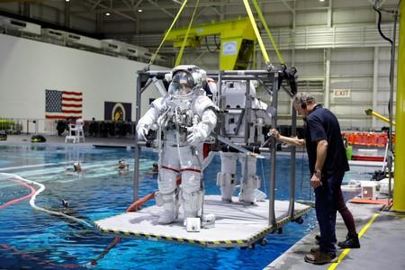 NASA Commercial Crew astronauts Sunita Williams and Josh Cassada are seen lowered into the water at NASA's Neutral Buoyancy Laboratory (NBL) training facility near the Johnson Space Center in Houston
