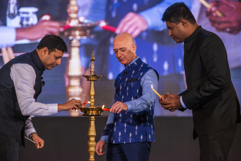 NEW DELHI, INDIA - JANUARY 16: Amazon CEO Jeff Bezos along with Amazon India Chief Amit Agarwal lights the ceremonial lamp during the Amazon's annual Smbhav event at Jawahar Lal Nehru Stadium, on January 16, 2020 in New Delhi, India. (Photo by Pradeep Gaur/Mint via Getty Images)