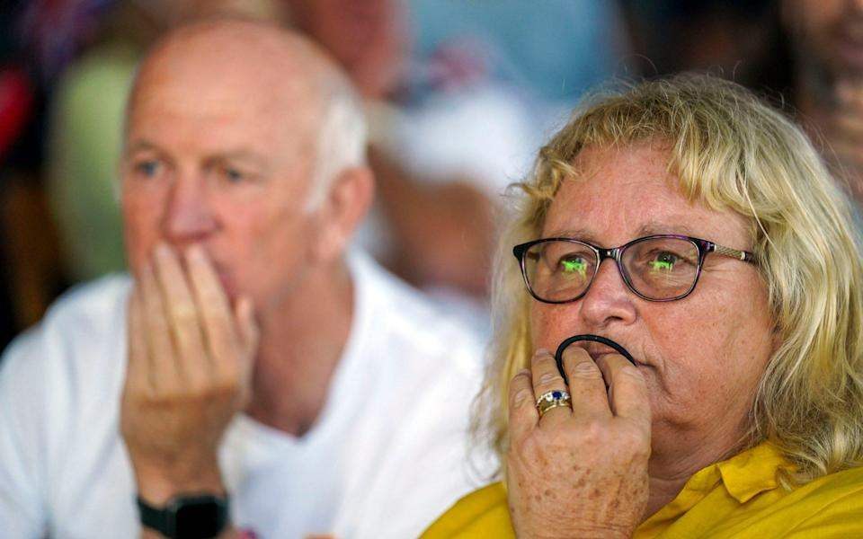 Mike and Caroline McIntyre had a nervous wait before their daughter secured gold - PA