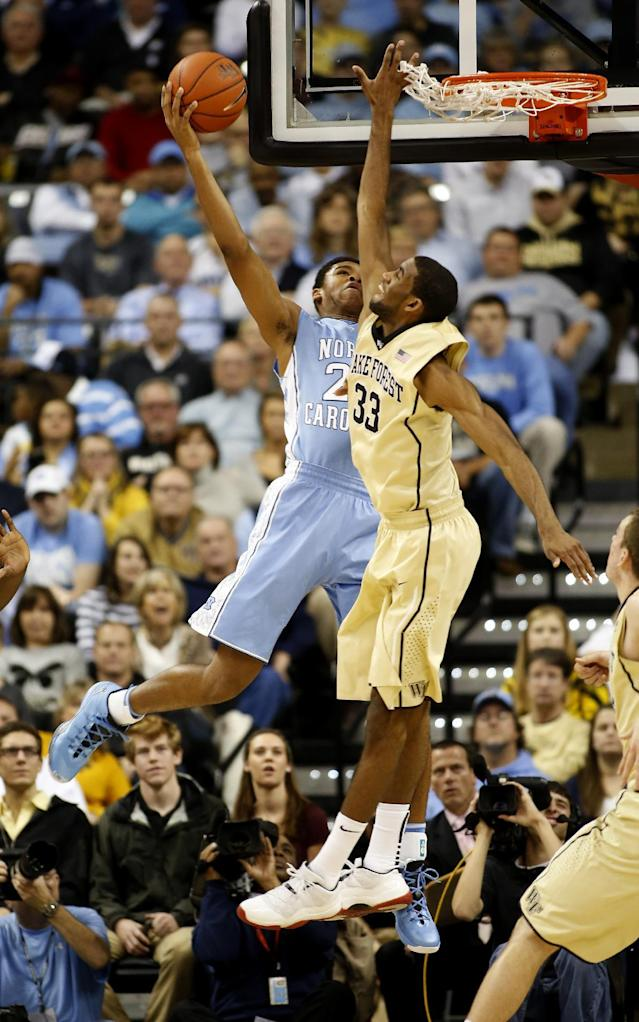 North Carolina forward Isaiah Hicks, left, drives against Wake Forest forward Aaron Rountree III in the first half of an NCAA college basketball game, Sunday, Jan. 5, 2014, in Winston-Salem, N.C. (AP Photo/Nell Redmond)