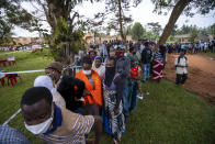 Ugandans wait to vote in Kampala, Uganda, Thursday, Jan. 14, 2021. Ugandans are voting in a presidential election tainted by widespread violence that some fear could escalate as security forces try to stop supporters of leading opposition challenger BobiWine from monitoring polling stations.(AP Photo/Jerome Delay)