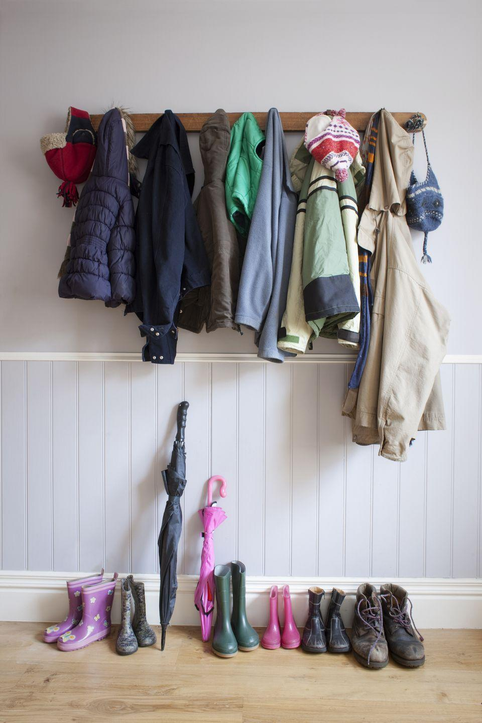 """<p>Keep everything you need to fly out the door <em>by</em> the door, so you can avoid running around the house when it's time to go. Hang coats and backpacks <a href=""""https://www.amazon.com/Rustic-Wall-Mounted-Coat-Shelf/dp/B07GBFRQYY/?tag=syn-yahoo-20&ascsubtag=%5Bartid%7C10055.g.2358%5Bsrc%7Cyahoo-us"""" rel=""""nofollow noopener"""" target=""""_blank"""" data-ylk=""""slk:on hooks"""" class=""""link rapid-noclick-resp"""">on hooks</a> and keep shoes (and clean socks!) below.</p>"""