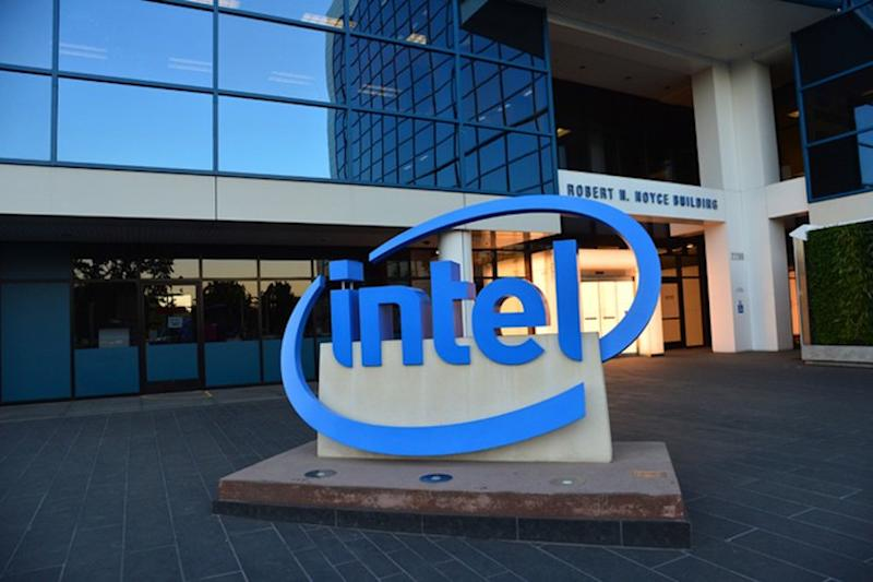 Intel headquarters, with a statue of the Intel logo in front.