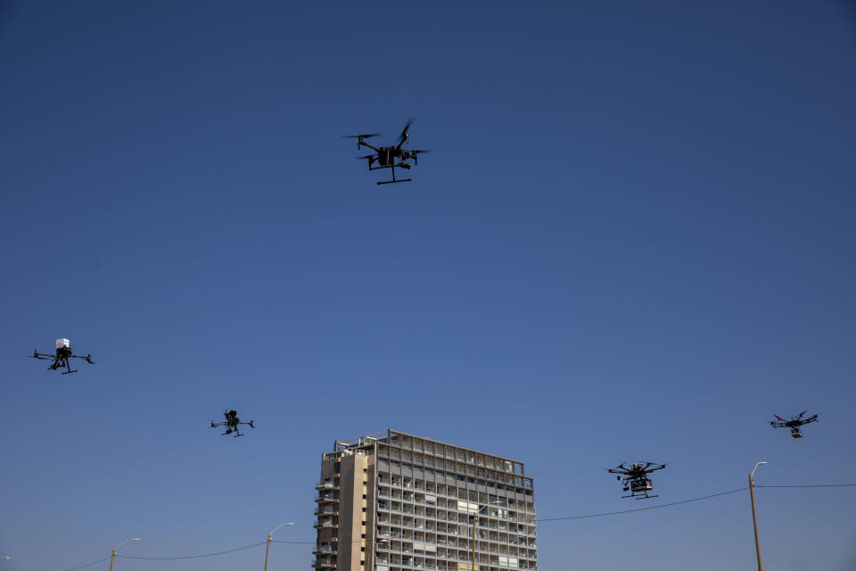 Drones carry goods as part of the National Drone Initiative test operation and demonstration for journalists, in Tel Aviv, Israel, Monday, Oct. 11, 2021. This was the third demonstration in Israel of the drone pilot program set to deliver goods and medicine across Israel. (AP Photo/Oded Balilty)