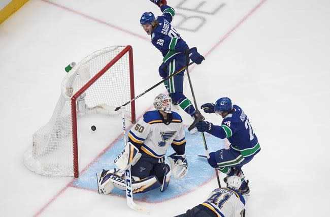 Canucks win 6-2, knock defending champion St. Louis Blues out of NHL playoffs
