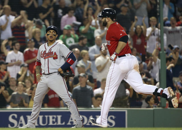 Atlanta Braves third baseman Johan Camargo, left, watches Boston Red Sox's Mitch Moreland round the bases after his solo home run in the eighth inning of an interleague baseball game at Fenway Park, Friday, May 25, 2018, in Boston. (AP Photo/Elise Amendola)
