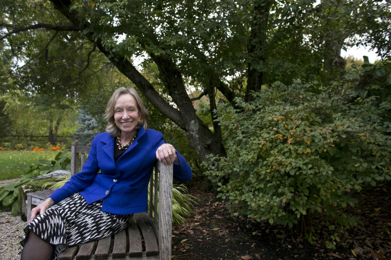 """In this Monday, Oct. 7, 2013 photo author Doris Kearns Goodwin poses for a portrait outside at her home in Concord, Mass. Goodwin's latest book,""""The Bully Pulpit: Theodore Roosevelt, William Howard Taft, and the Golden Age of Journalism,"""" will be released on Nov. 5. (AP Photo/Steven Senne)"""