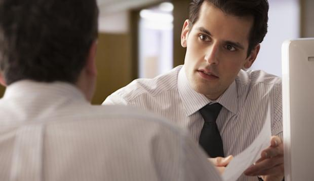 Young  Businessman going over report with older colleague
