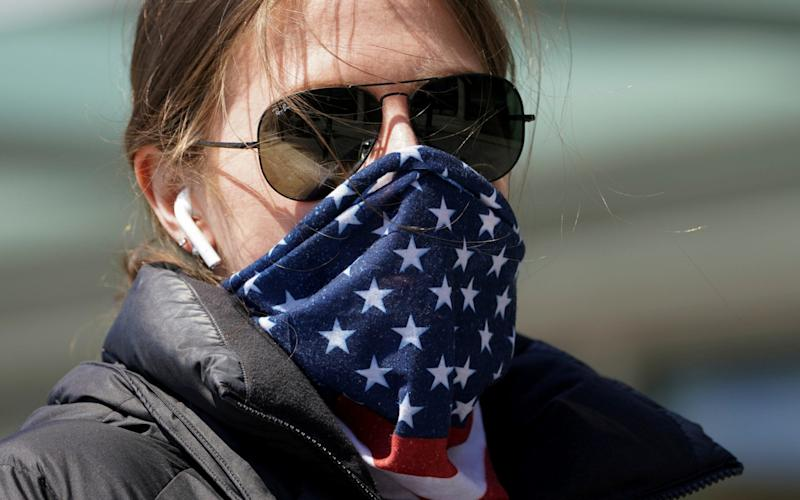 Americans should wear a scarf and void buying medical-grade face masks, the White House said - Kevin Lamarque/Reuters