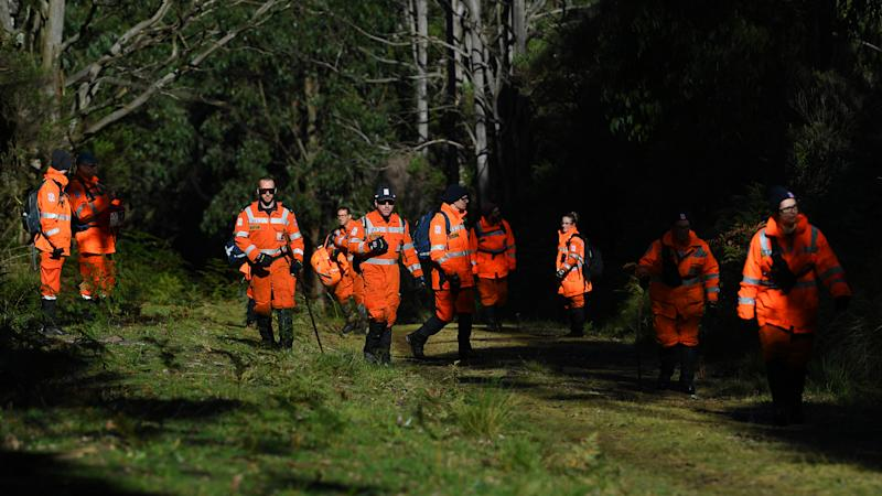 SES personnel shown searching dense forrest in Mt Disappointment for Will Callaghan. Source: AAP