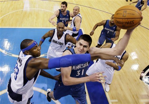 Minnesota Timberwolves' Darko Milicic (31), of Serbia, shoots against Dallas Mavericks' Brendan Haywood, left, in the first half of an NBA basketball game, Wednesday, Jan. 25, 2012, in Dallas. (AP Photo/Tony Gutierrez)