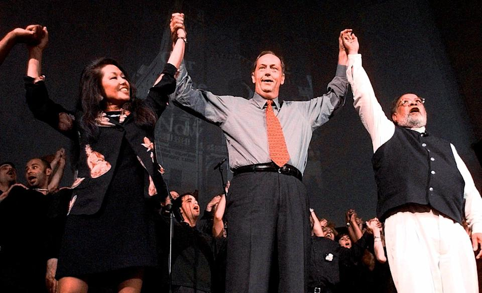 In this June 20, 1999 file photo, Janice Mirikitani, left, joins hands with Bill Bradley, center, and the Rev. Cecil Williams during services at Glide Memorial United Methodist Church in San Francisco.