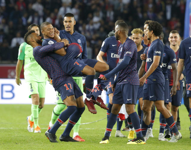 PSG's Eric Maxim Choupo-Moting congratulates PSG's Kylian Mbappe after the French League One soccer match between Paris-Saint-Germain and Lyon at the Parc des Princes stadium in Paris, France, Sunday, Oct. 7, 2018. (AP Photo/Michel Euler)