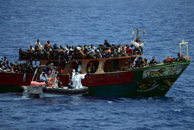 A French Navy patrol ship rescues migrants aboard a fishing boat in the Mediterranean Sea, on May 20, 2015 (AFP Photo/)