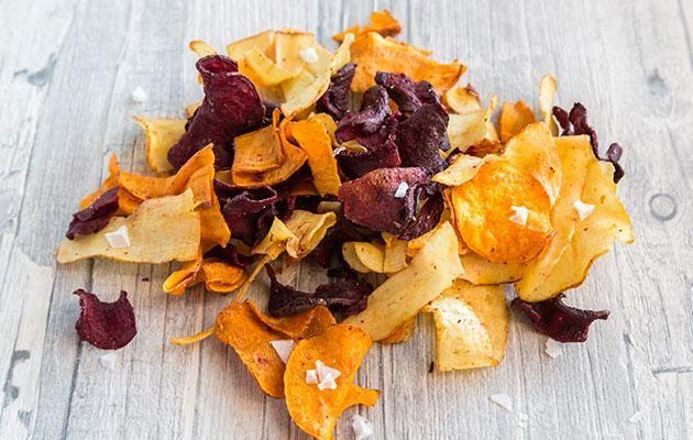 Veggie chips made of sweet potato, beetroot and parsnip have become popular in recent years. Photo: Getty