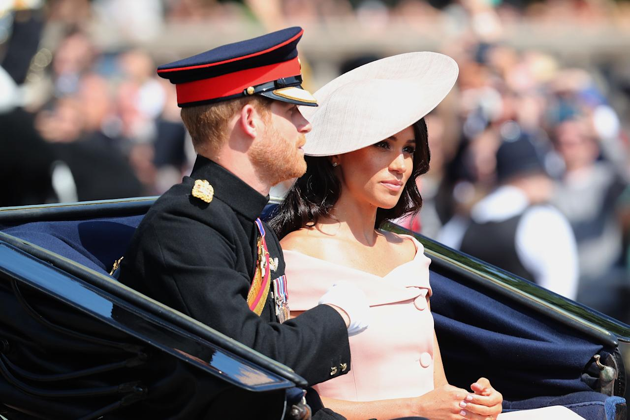 <p>Meghan Markle wears a custom Carolina Herrera dress with a bespoke Philip Treacy hat (the same she wore to the Buckingham Palace Garden party) while Prince Harry donned his Blues and Royals uniform.<em> [Photo: Getty]</em> </p>