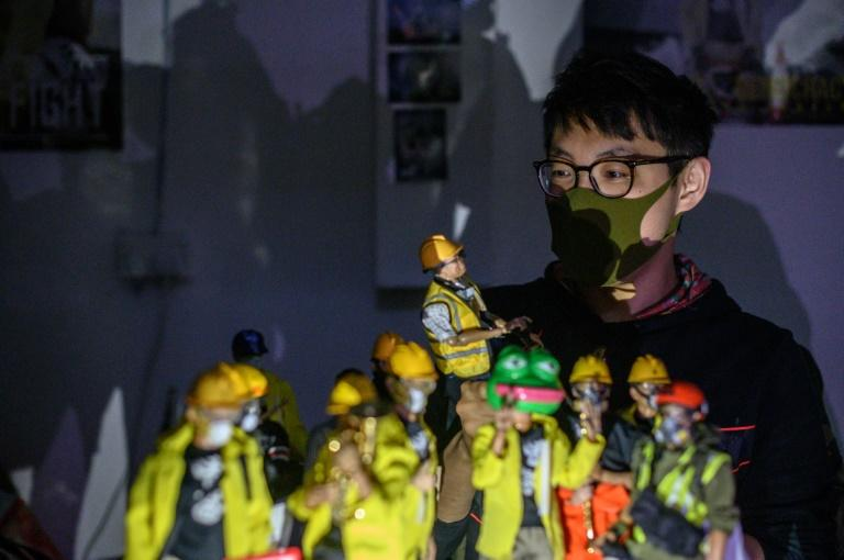 The different parts of the figures had to be manufactured in seven countries to avoid political sensitivities -- especially in mainland China (AFP Photo/Philip FONG)
