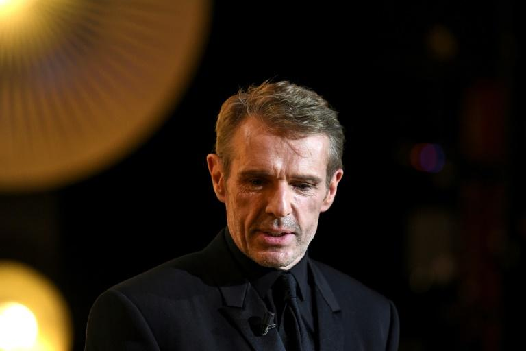 People whistled and shouted slogans as  Lambert Wilson gave a concert of Kurt Weill songs