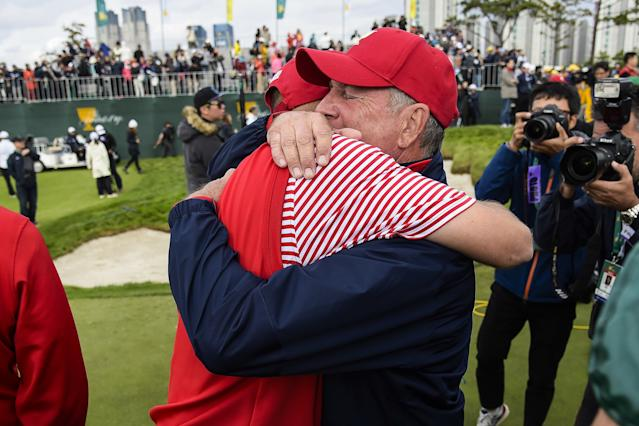"""<h1 class=""""title"""">The Presidents Cup - Final Round</h1> <div class=""""caption""""> INCHEON CITY, SOUTH KOREA - OCTOBER 11: Bill Haas of Team USA hugs Captain <a class=""""link rapid-noclick-resp"""" href=""""/golf/champions/players/Jay+Haas/17"""" data-ylk=""""slk:Jay Haas"""">Jay Haas</a> after securing the winning point against Sangmoon Bae of Korea on the International Team on the 18th hole during Sunday singles matches in the final round of The Presidents Cup at Jack Nicklaus Golf Club Korea on October 11, 2015 in Songdo IBD, Incheon City, South Korea. (Photo by Chris Condon/PGA TOUR) </div> <cite class=""""credit"""">Chris Condon</cite>"""