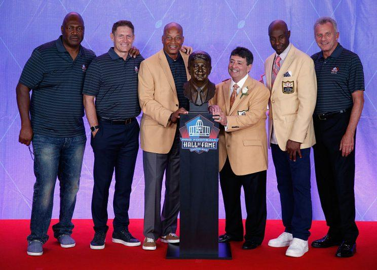 Edward DeBartolo, Jr. (3rd R), former San Francisco 49ers Owner, is seen with his bronze bust alongside former San Francisco 49ers, Charles Haley (L), Steve Young (2nd L), Ronnie Lott (3rd L), Jerry Rice (2nd R) and Joe Montana (R) during the NFL Hall of Fame Enshrinement Ceremony. (Getty Images)