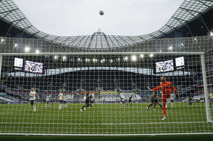 Newcastle's Callum Wilson, background right, celebrates after scoring on a penalty kick during the English Premier League soccer match between Tottenham and Newcastle at the Tottenham Hotspur Stadium in London, Sunday, Sept. 27, 2020. (Andrew Boyers/Pool via AP)